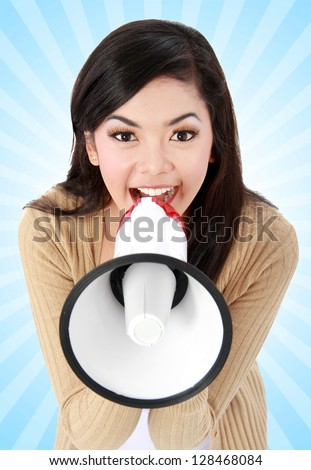 young girl shouting in megaphone - stock photo