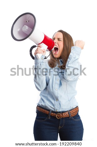 young girl shouting with megaphone - stock photo