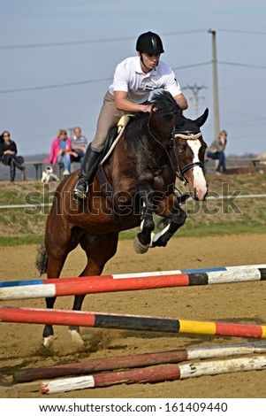 young girl show jumping - stock photo