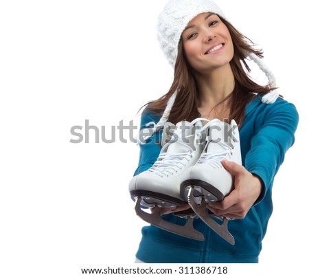 Young girl showing giving ice skates for winter ice skating sport activity in white hat happy smiling isolated on a white background