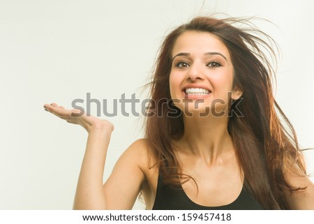 Young girl showing her tooth and smiling - stock photo