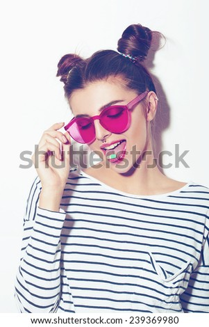 young girl showing tongue in pink sunglasses. hipster have fun. teen. lifestyle. - stock photo