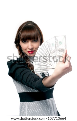 Young girl shows a fan of money. On a white background.