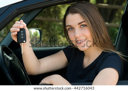 Young girl shows her car key