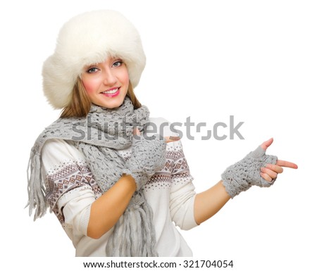 Young girl shows pointing gesture isolated - stock photo