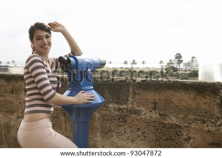Young girl sightseeing at a city observatory. - stock photo