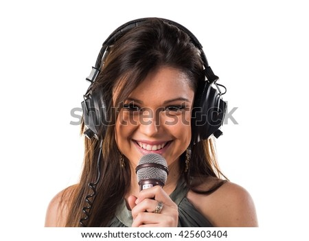 Young girl singing with microphone - stock photo