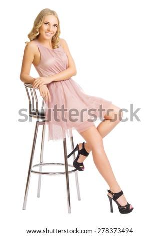 Young girl sit on metallic chair isolated - stock photo