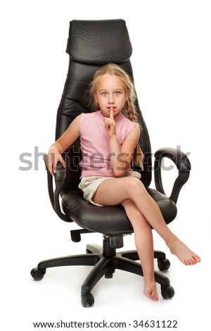 Young girl sitting on a chair - stock photo