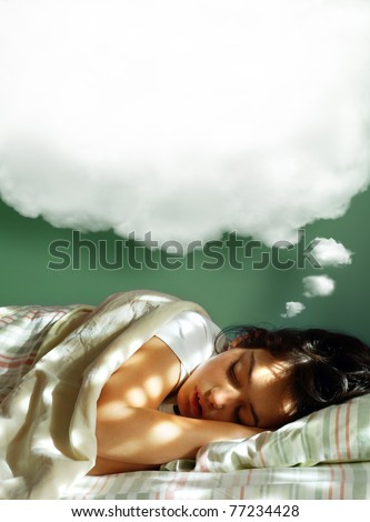 Young girl sleeping in her bed, with a dreaming fluffy balloon above her head - stock photo