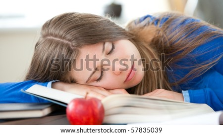 Young girl sleeping in living room at home
