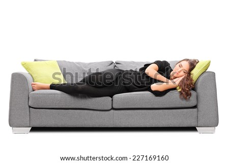Young girl sleeping on a sofa isolated on white background - stock photo