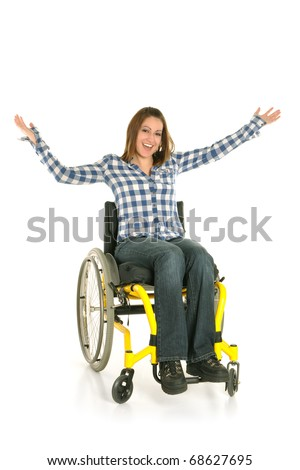 Young girl smiling in wheelchair - stock photo