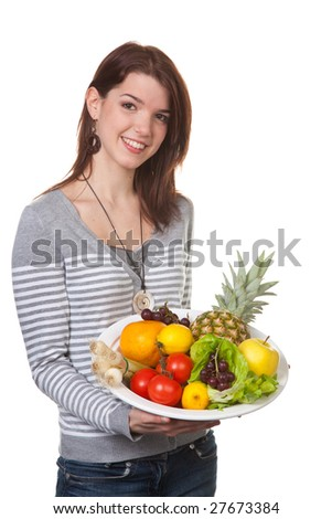 Young girl smiling presents a lush fruit bowl