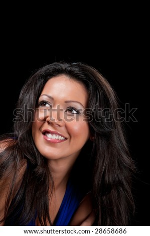 Young girl smiling very happy, black background space for copy.