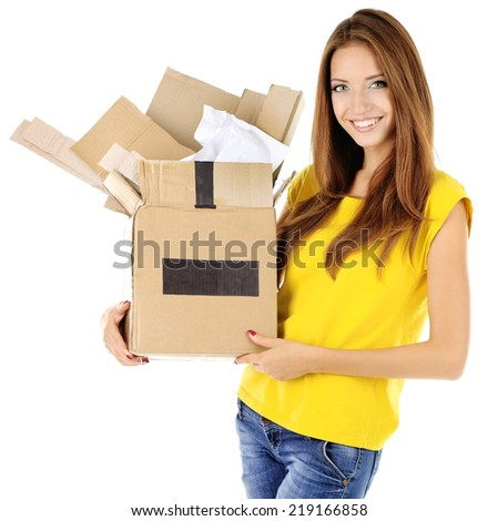Young girl sorting paper and cardboard isolated on white - stock photo