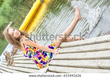 young girl splashes water her feet stock photo edit now 615441626