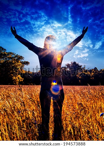 Young girl spreading hands with joy and inspiration facing the sun,sun greeting,freedom, - stock photo