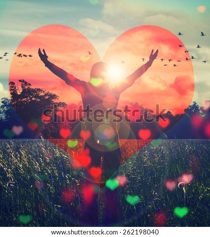 Young girl spreading hands with joy and inspiration facing the sun,sun greeting,freedom concept,bird flying above sign of freedom and liberty,with big red heart  - stock photo