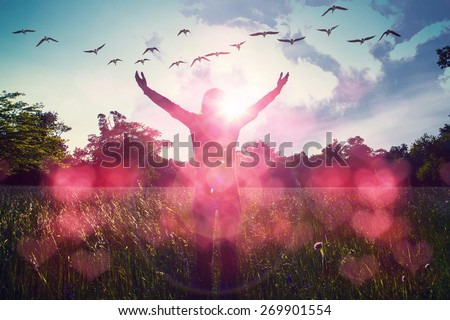 Young girl spreading hands with joy and inspiration facing the sun,sun greeting,freedom concept,bird flying above sign of freedom and liberty,red heart bokeh  - stock photo