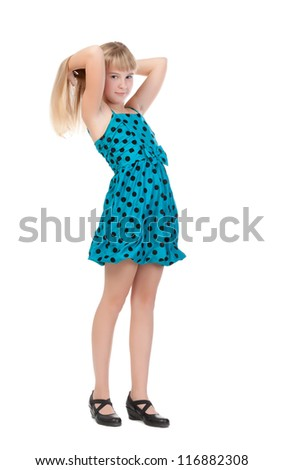 Young Girl Standing In Studio, isolated on white background - stock photo
