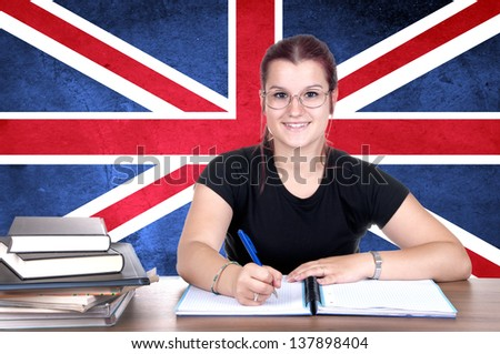 young girl student pc on the background with british national flag. english language learning concept - stock photo