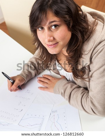 Young Girl Studying at Home - stock photo