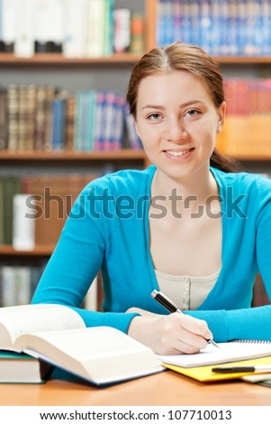 young girl studying in library