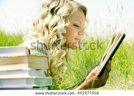 Young girl studying on fresh air