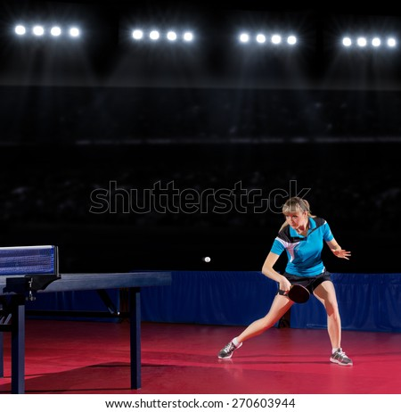 Young girl table tennis player at sports hall - stock photo