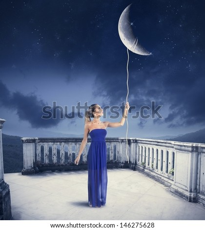 Young girl takes the Moon with rope.Moon provided by NASA - stock photo