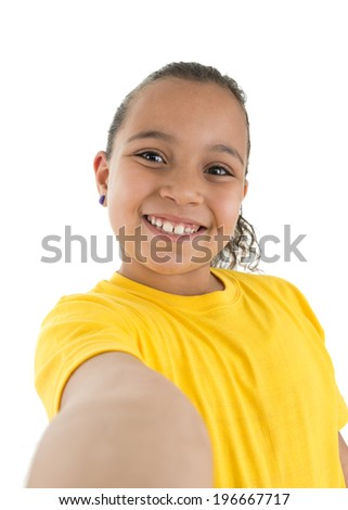 Young Girl Taking a self portait Isolated on White Background