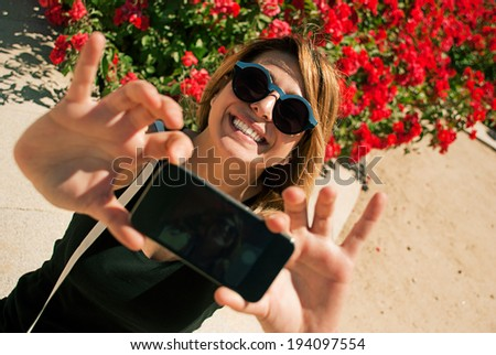 Young girl taking a selfie. - stock photo