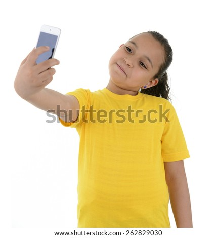 Young Girl Taking a Selfie With Phone Camera Isolated on White Background - stock photo