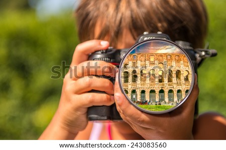 Young girl taking photos of Colosseum by professional digital camera. - stock photo