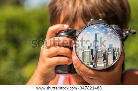 Young girl taking photos of Lower Manhattan by professional digital camera.