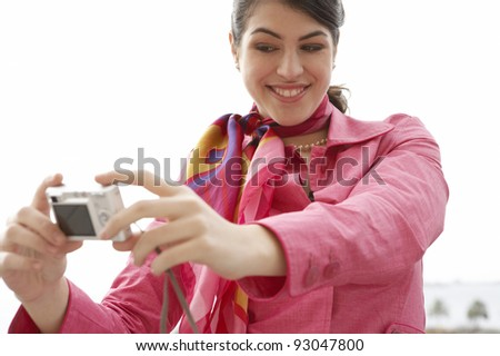 Young girl taking pictures of herself while sightseeing. - stock photo