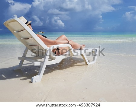 young girl taking sun in the Caribbean - stock photo