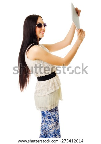 Young girl talking by tablet PC isolated - stock photo