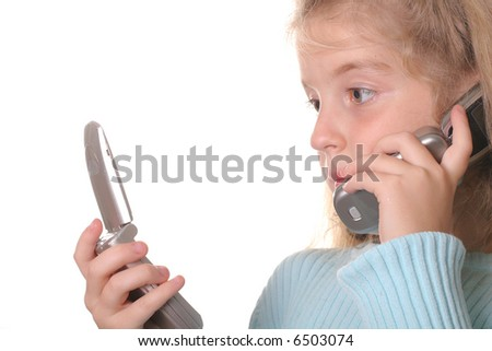 young girl talking on a cell phone looking at another phone