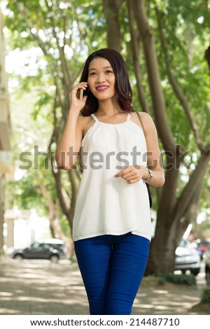 Young girl talking on the cellphone - stock photo