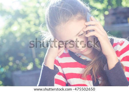Young girl talking to cell phone