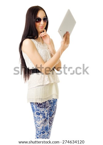 Young girl talks by tablet PC isolated - stock photo