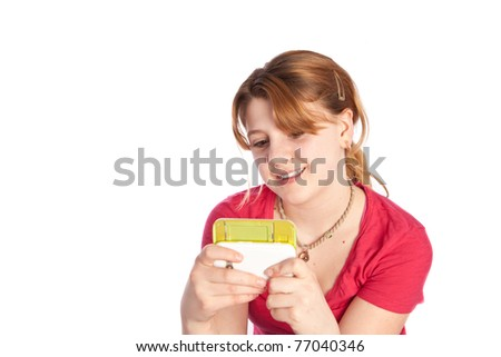 young girl texting on her phone isolated on a white background - stock photo