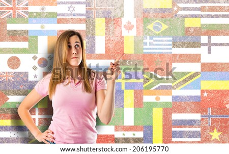 Young girl thinking over isolated flags background  - stock photo