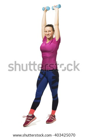 Young girl training with dumbbells