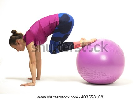 Young girl training with fitball
