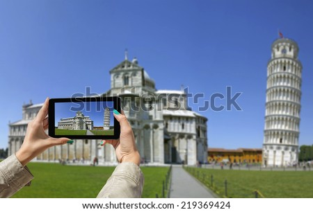 Young girl traveling and taken pictures Leaning Tower in Pisa, with tablet - stock photo