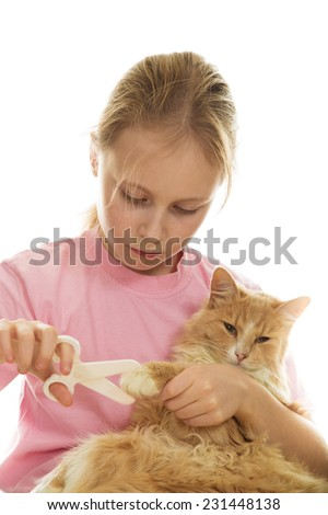 Young girl treats her kitten on a white background.