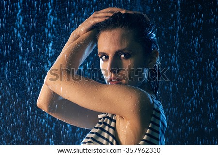 Young Girl Under Drops Water - stock photo